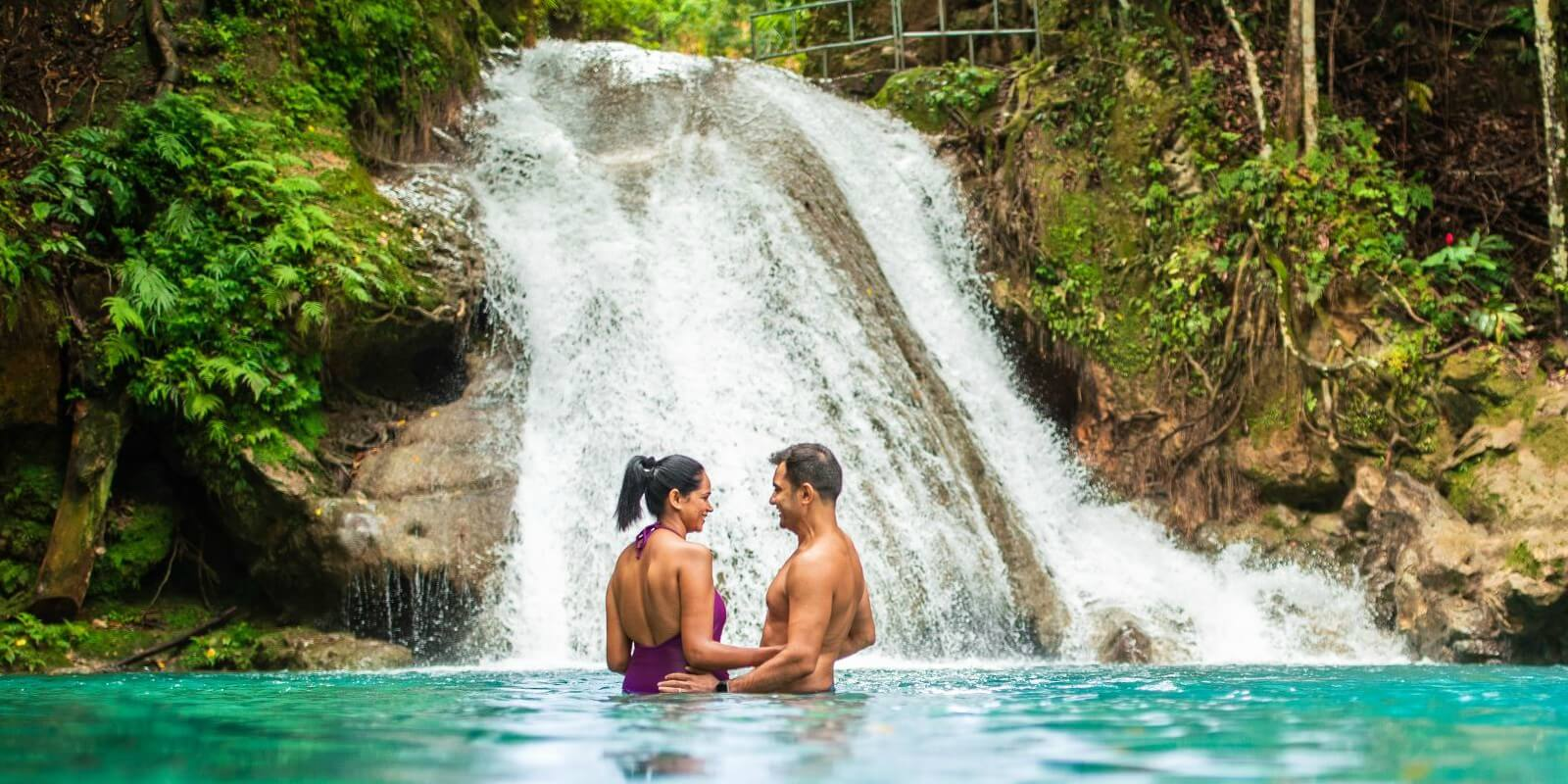Couple enjoying a secluded Jamaican waterfall