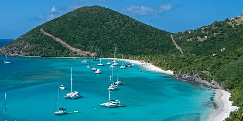 Aerial view of the green hills down to to the coast in British Virgin Islands