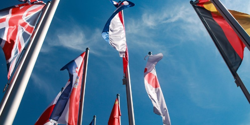 international flags flapping in the wind
