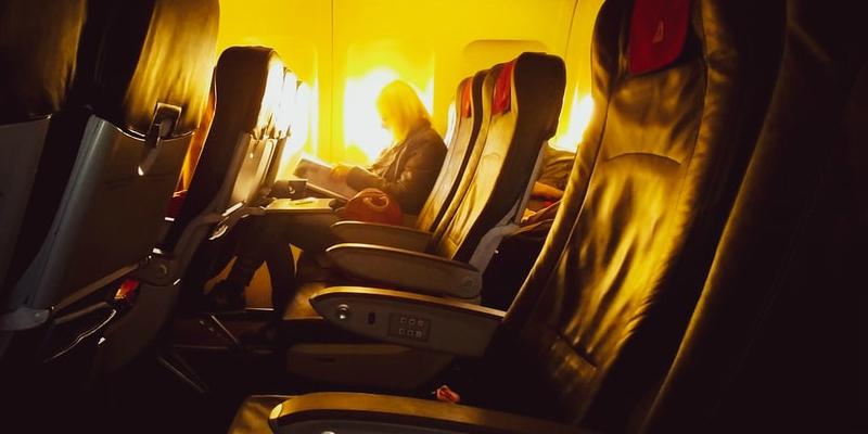 Woman sitting on a plane
