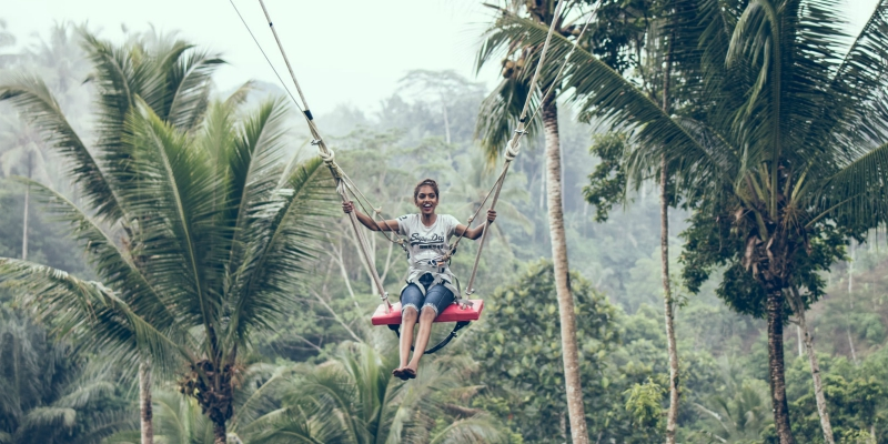 Woman a swing in the jungle