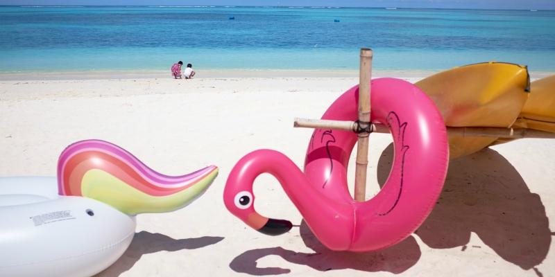 Inflatables on a Caribbean beach scene
