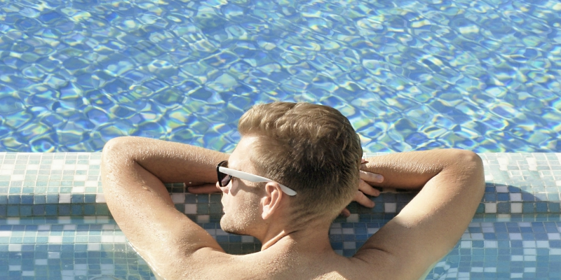 Man relaxing in a pool
