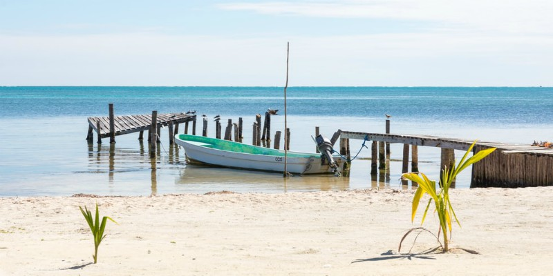 A boat moored on the sand on a beach