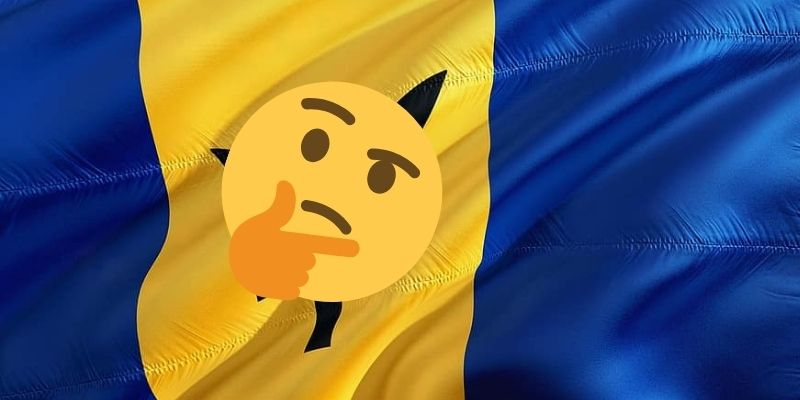 What symbol lies in the middle of the Barbados flag?