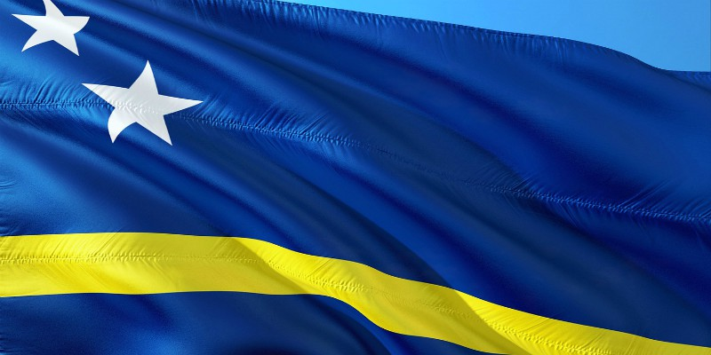 Can you name this blue flag with white stars and a yellow horizontal band