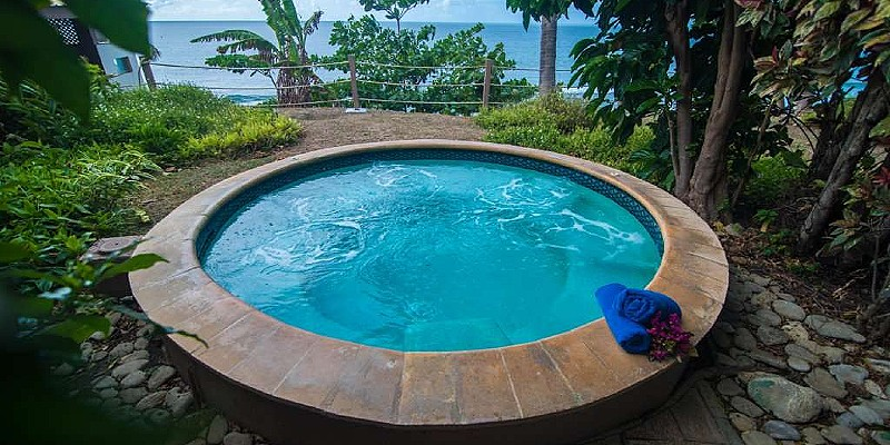 You can take a dip in a hot tub as you stare out over the Caribbean Sea at Tropikist Beach Hotel & Resort