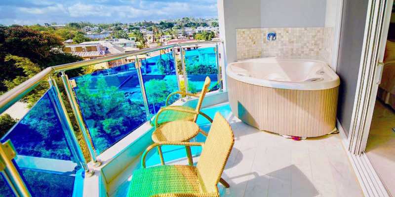 Luxury Ocean View Room featuring Private Balcony with a Jacuzzi