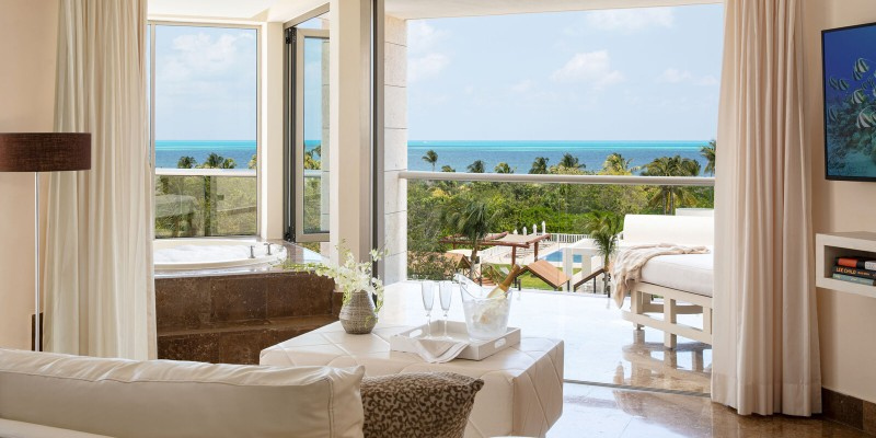 Living area and Jacuzzi in a Junior Suite at Beloved Playa Mujeres by The Excellence Collection