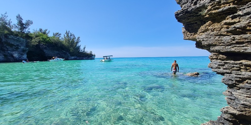 Man wading in the turquoise waters in Bermuda