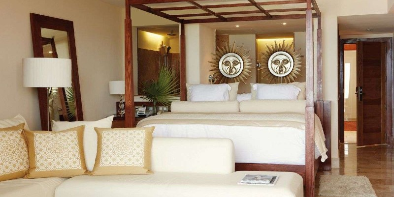 In the bedroom of a Junior Suite at Excellence Playa Mujeres