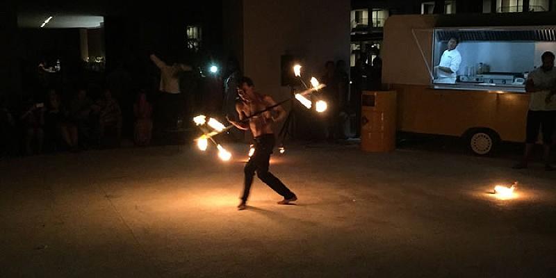 A fire dancer entertains the crowds