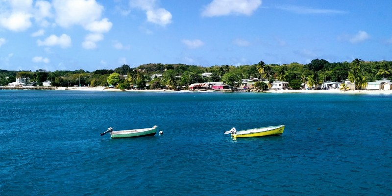 Two boats float of the shore of Barbados