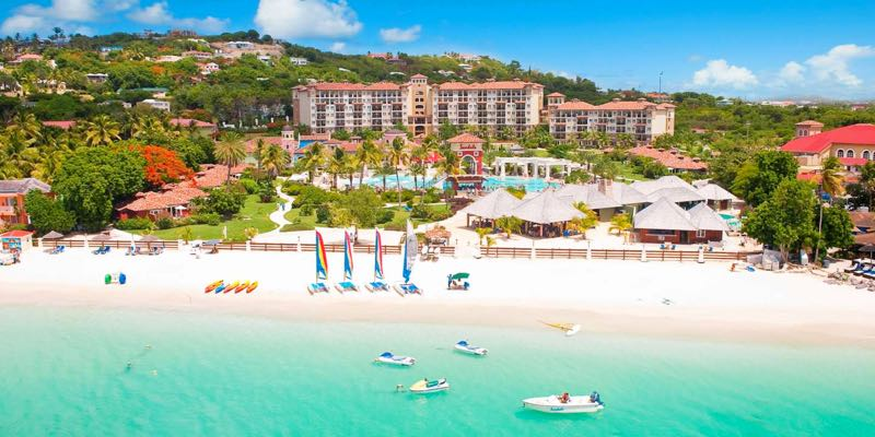 Aerial shot of the beachfront location where Sandals Grande Antigua Resort & Spa finds itself