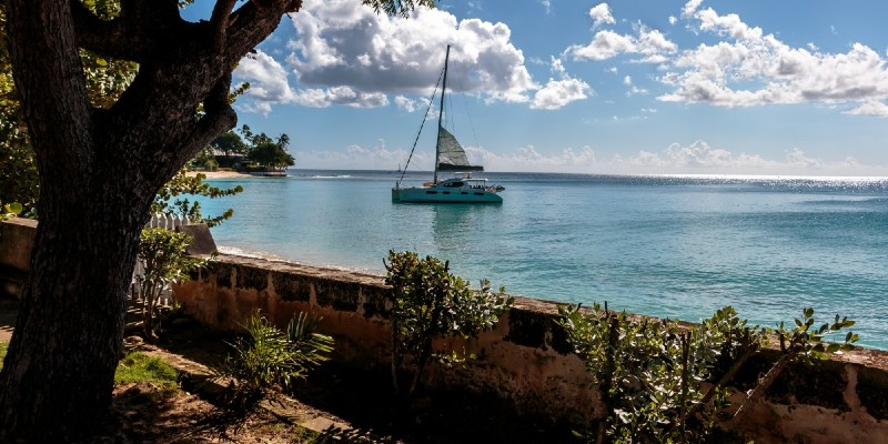 View of the Caribbean Sea from Barbados coast with a boat sailing