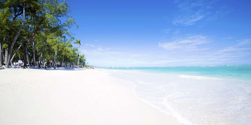 Blue Caribbean Sea waters lapping against the white sand in Punta Cana, Dominican Republic