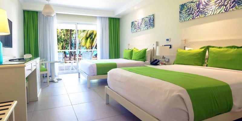 Inside a spacious and colourful Sea View Room at Vista Sol Punta Cana Resort & Spa