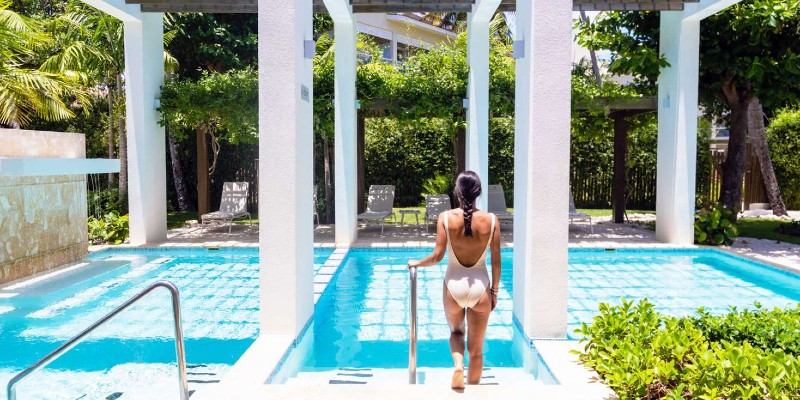 A woman walking into a pool in Punta Cana